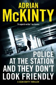 Adrian McKinty – Police at the Station and They Don't Look Friendly